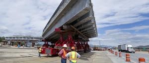 photo: Utah Department of Transportation workers inspect a highway bridge under construction on Interstate 15 in American Fork, Utah.