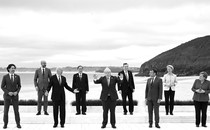 The leaders attending the G7 pose for a photograph on the coast.