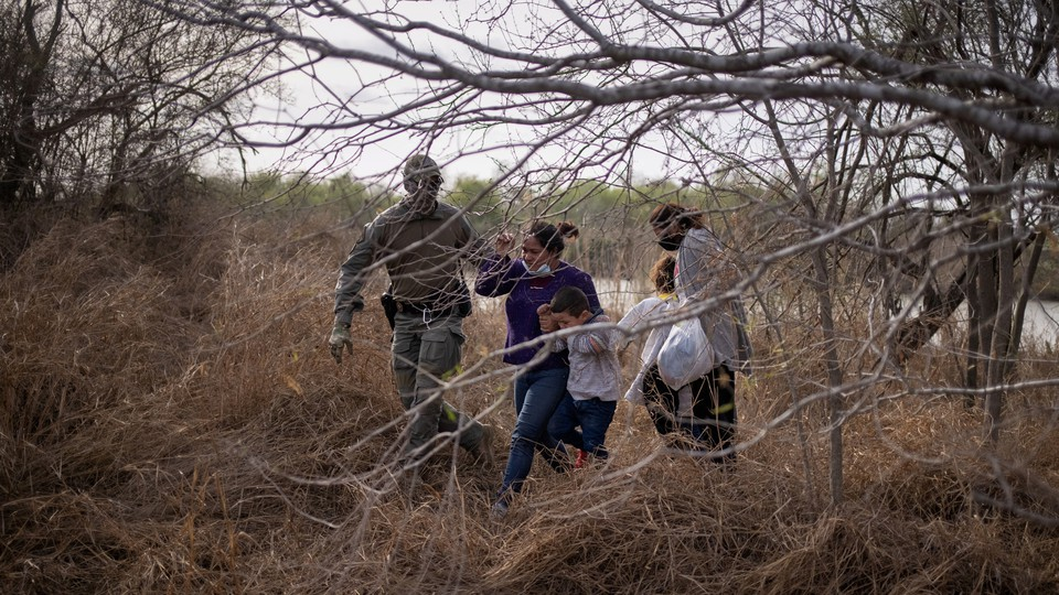 A family crossing the U.S.-Mexico border.