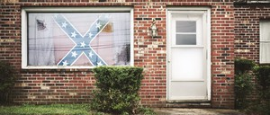 A house with a Confederate flag is pictured.