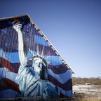 A mural of the Statues of Liberty and an American flag on a barn in Iowa