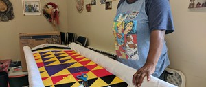 Mary Margaret Pettway with a replica of one of her mother's best-known quilts in Boykin, formerly Gee's Bend, Alabama.
