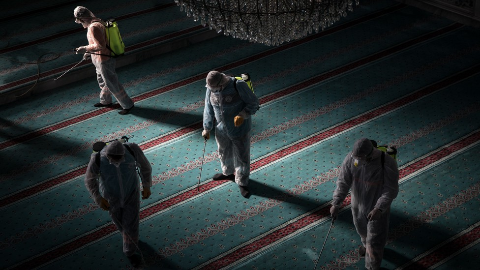 Workers in Istanbul disinfect a mosque to prevent the spread of the coronavirus.