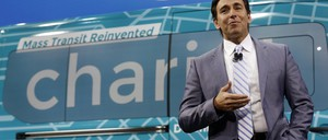 Mark Fields, CEO of Ford, stands in front of a Chariot shuttle.