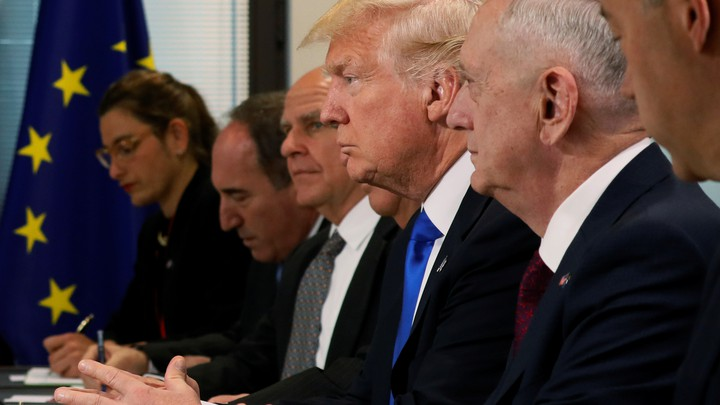 President Donald Trump sits with his delegation, including National Security Advisor H.R. McMaster and Secretary of Defense James Mattis during a meeting at the EU.