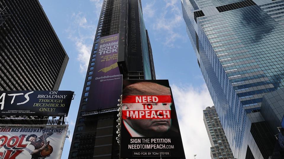 An Impeach Trump billboard in Times Square
