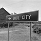 Sign to Soul City next to house