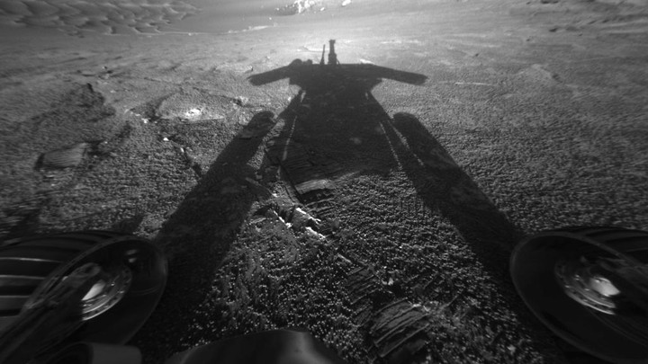 The Opportunity rover photographs its shadow on Mars.