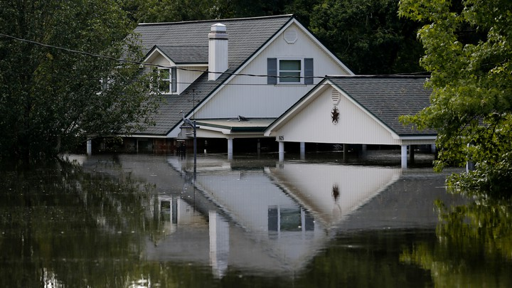 A two-story house halfway underwater