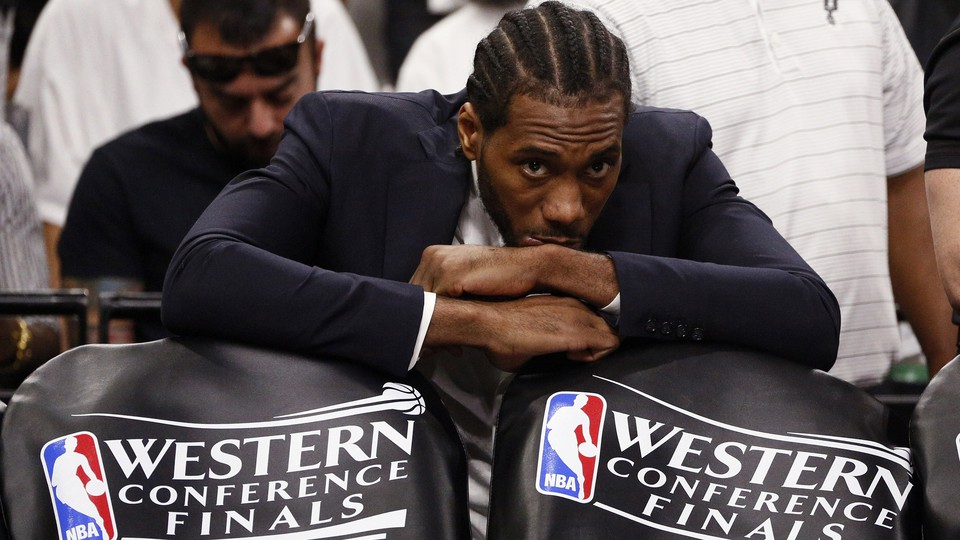 Kawhi Leonard watches from the sidelines at the 2017 Western Conference Finals