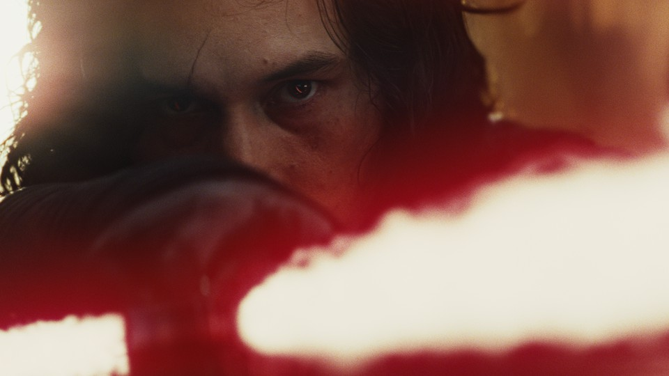Kylo Ren with a lightsaber in 'The Last Jedi'