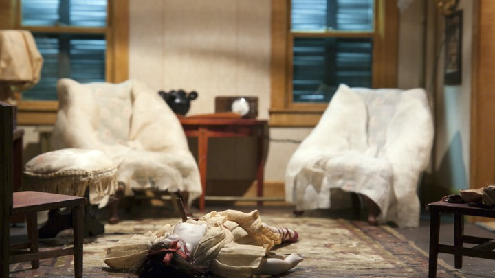 A diorama of a murder scene in a living room