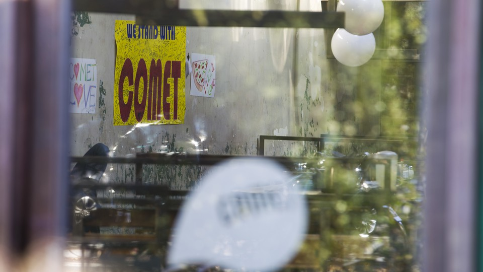 The front door of Comet Ping Pong on the day after the shooting.