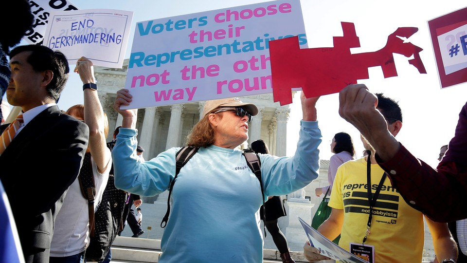 Demonstrators rally at the Supreme Court.