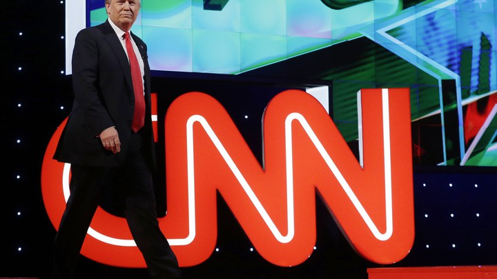 Donald Trump in front of the CNN logo