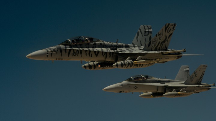 Two U.S. Marine Corps F-18 Super Hornets depart after receiving fuel from a 908th Expeditionary Air Refueling Squadron KC-10 Extender during a flight in support of Operation Inherent Resolve on May 31, 2017.