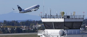 A plane takes off from Seattle-Tacoma International Airport
