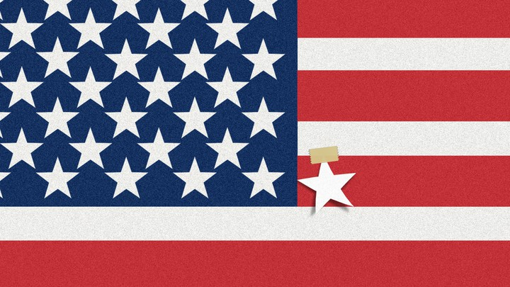 An image of an American flag, but with an extra white star taped on one of the red stripes.