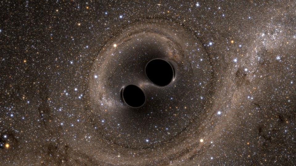 An illustration of a merger of two black holes, an event that produces gravitational waves