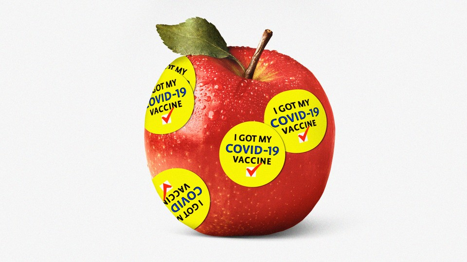 """Illustration of an apple covered in """"I got my COVID-19 vaccine"""" stickers"""