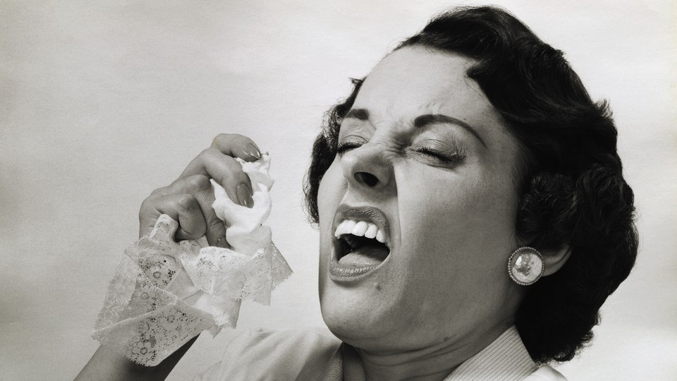 A woman about to sneeze
