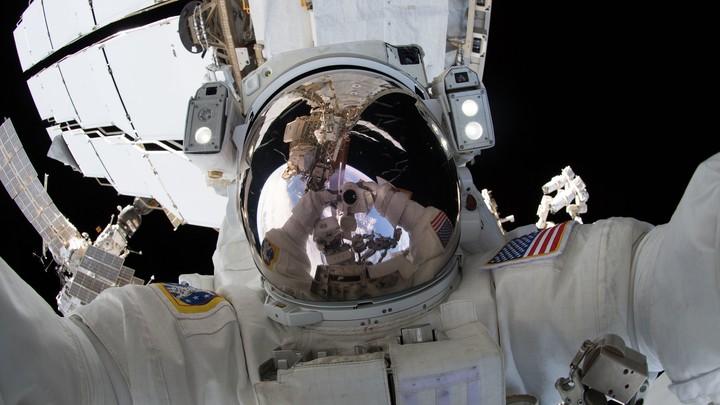An astronaut's reflective visor