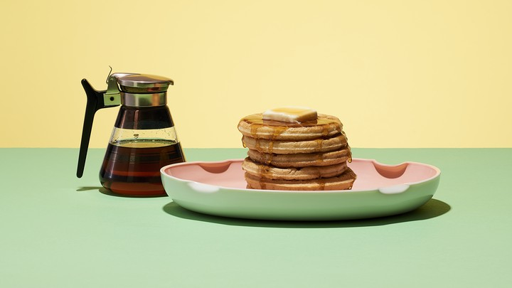 A stack of pancakes and syrup