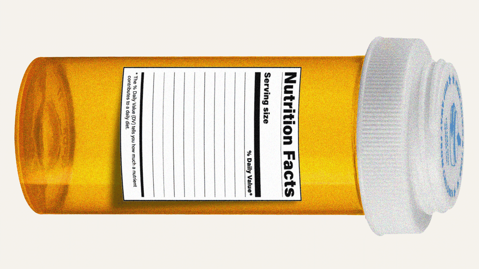 A pill bottle lays on its side with a nutrition label attached