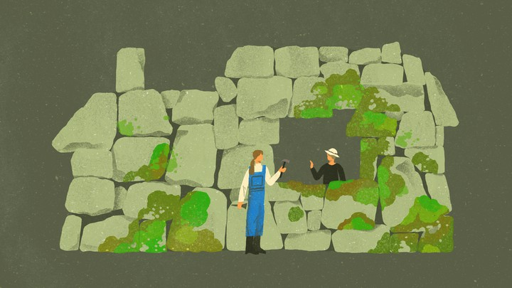 two women in a stone house