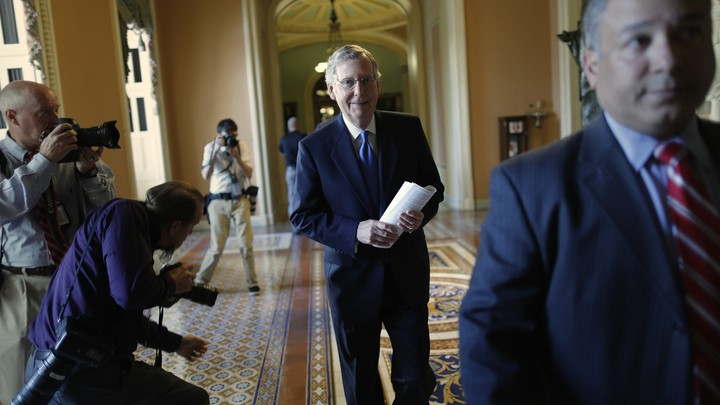 Senator Mitch McConnell walks to his office at the U.S. Capitol in Washington.