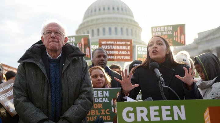 Senator Bernie Sanders and Representative Alexandria Ocasio-Cortez speak outside the United States Capitol