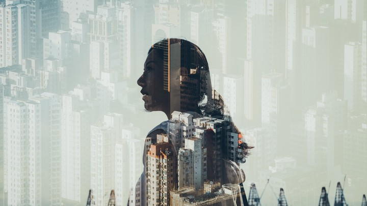 Woman's silhouette against cityscape