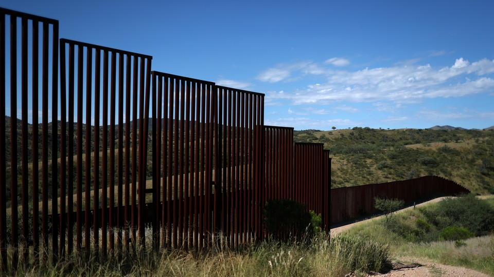 Different generations of the U.S. border wall with Mexico are seen from the United States in Nogales, Arizona