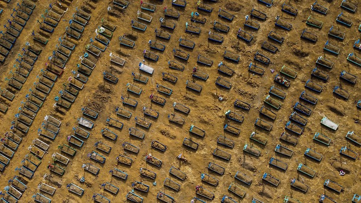 An aerial view of hundreds of graves