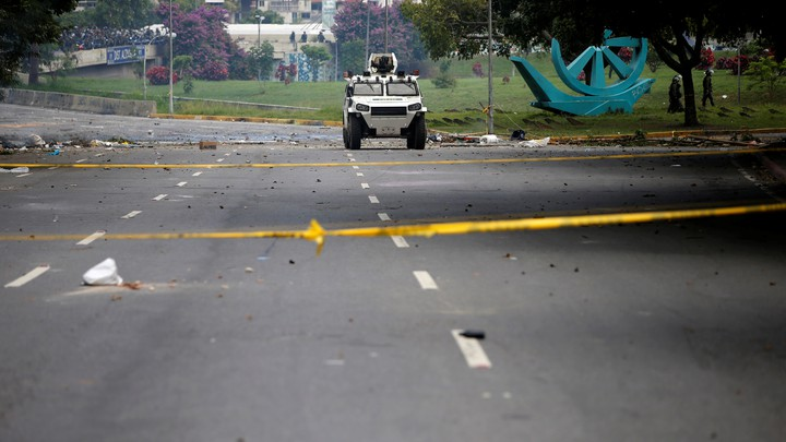 An armored vehicle drives along an empty street during an opposition strike in Caracas on July 20, 2017.