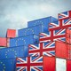 Shipping containers painted with the European flag and the Union Jack sit next to each other.