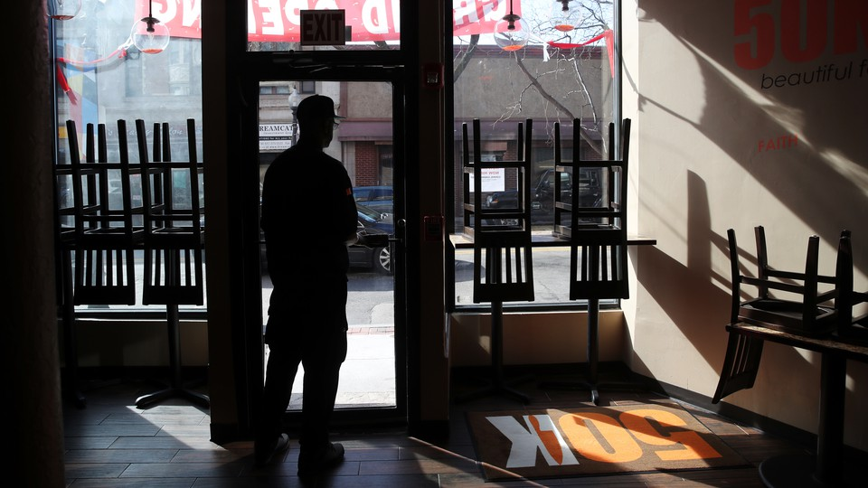 Owner and chef Anthony Caldwell looks out from 50Kitchen in the Field's Corner neighborhood of Boston on March 18. His grand opening of the restaurant was three weeks ago, but because of the coronavirus, the restaurant has switched to takeout-only.