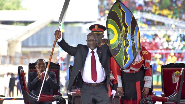 At his inaugural ceremony in 2015, John Magufuli holds a ceremonial shield and spear to signify the beginning of his presidency.
