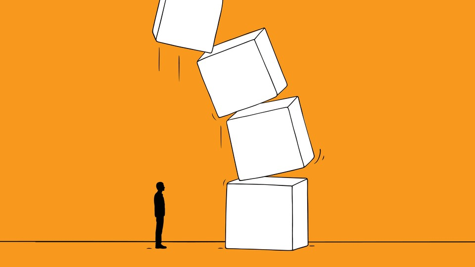 A small figure stands in front of a big stack of toppling boxes.