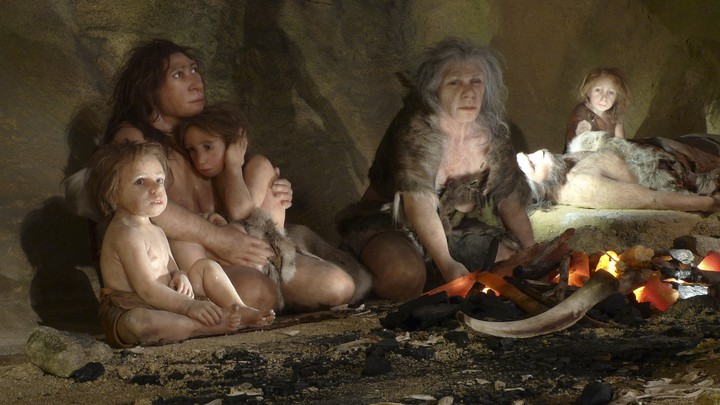 A painting of Neanderthal children and adults sitting near a fire