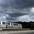 A photo of a Bay Area Rapid Transit train making its way along the tracks in Oakland, California.