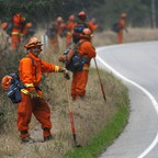 Inmates holding a fire line during a burn out operation in Big Sur, California, December 2013.