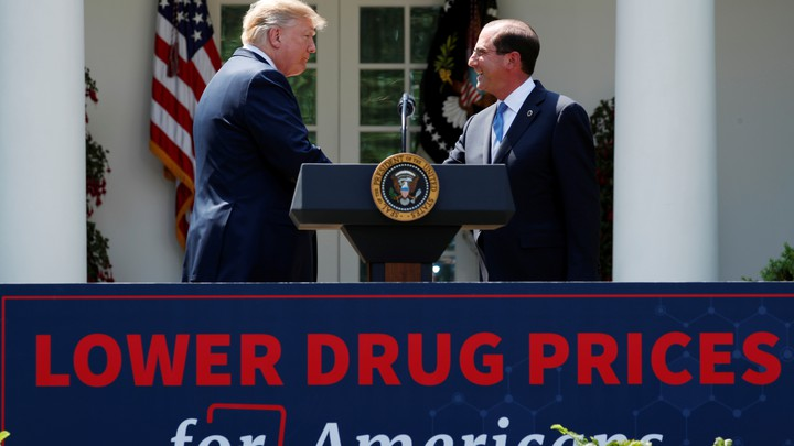 President Trump shakes hands with Health and Human Services Secretary Alex Azar after delivering a speech on prescription-drug prices.