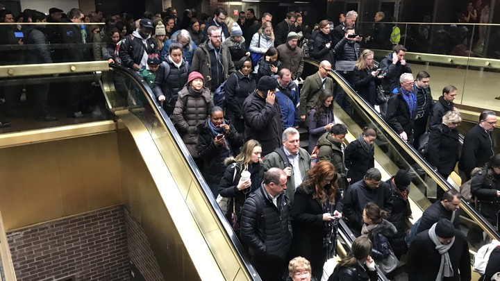 Commuters exit the New York Port Authority after reports of an explosion.