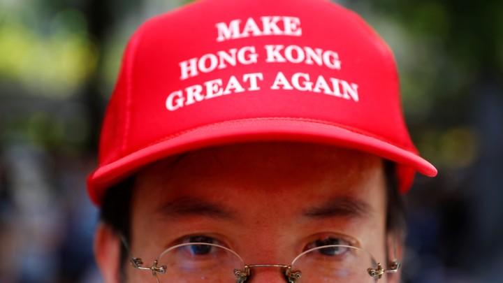 Photo of protestor in Hong Kong wearing Make Hong Kong Great Again hat