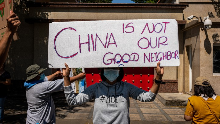 Protesters gather in front of the Chinese Embassy on February 11, 2021, in Yangon, Myanmar.