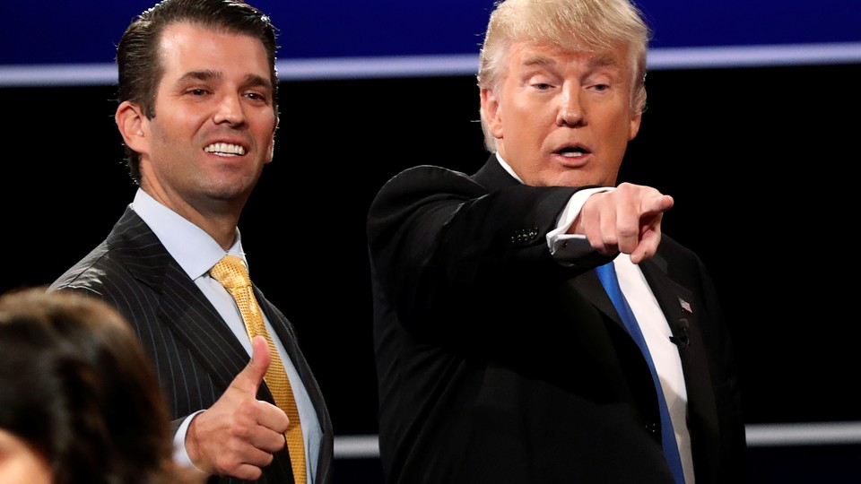 Donald Trump Jr. gives a thumbs up beside his father Donald Trump.