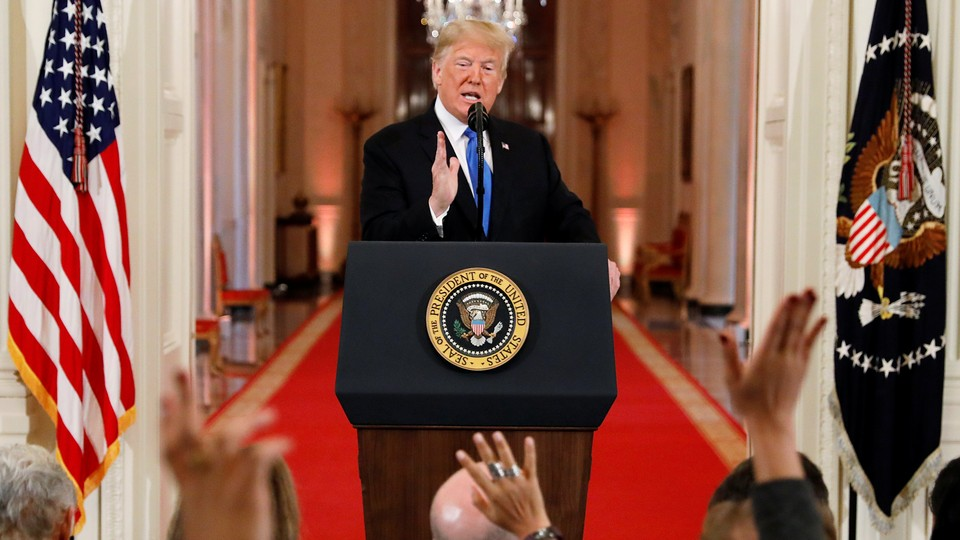 Trump addresses reporters at a post-midterms press conference.