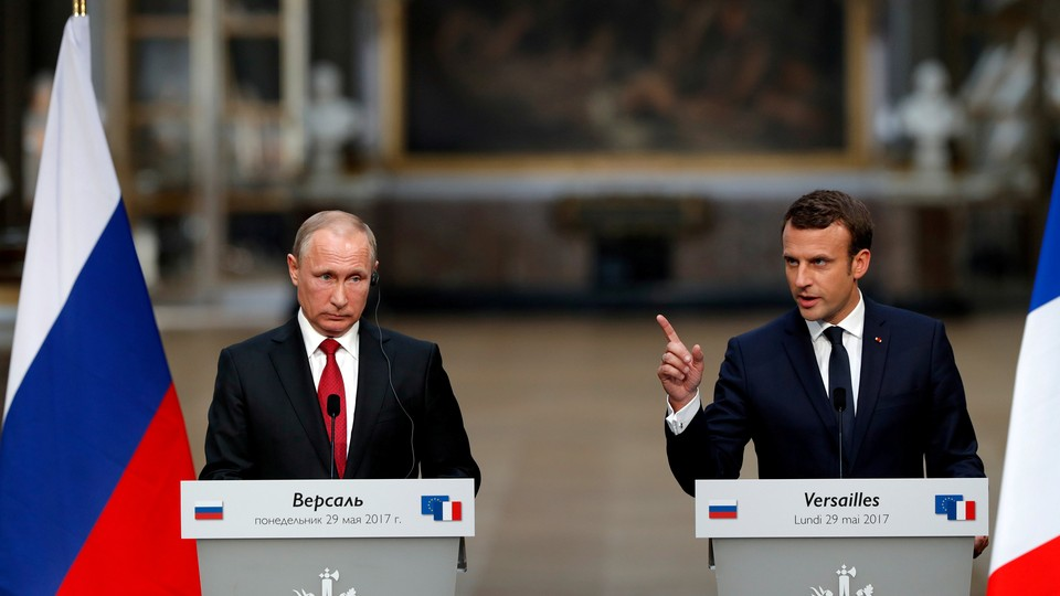French President Emmanuel Macron and Russian President Vladimir Putin give a joint press conference at the Chateau de Versailles on May 29, 2017.