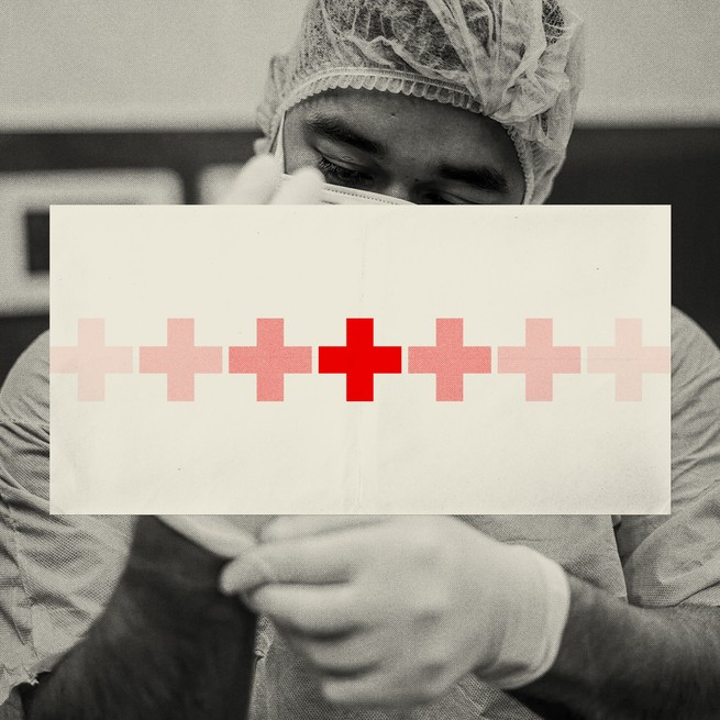 A masked health care worker in black & white with his face blocked by a white rectangle with a line of fading red crosses going across its middle